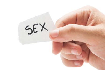 Sex message concept  using a hand holding a small piece of paper on white background photo