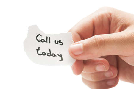 Call us today message concept  using a hand holding a small piece of paper on white background photo