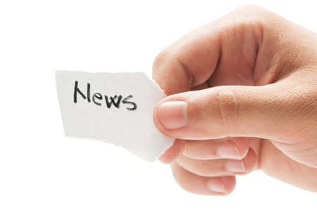 News message concept  using a hand holding a small piece of paper on white background photo