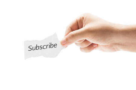 Subscribe concept using a piece of paper held by a hand on white background. photo