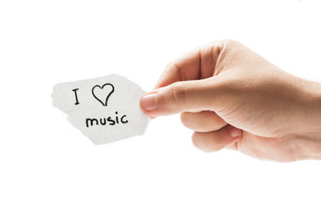 I love music concept using a hand holding a piece of paper and the text written by hand with a permanent marker photo