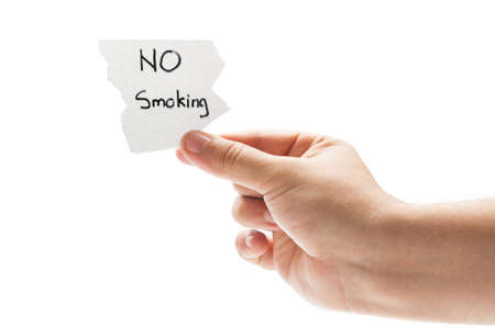 No smoking concept using a hand holding a piece of paper and the text written by hand with a permanent marker photo