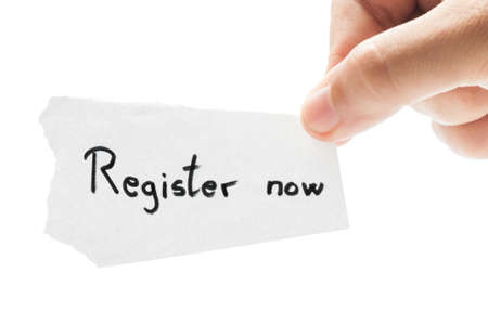 Register now concept using a hand holding a piece of paper and the text written by hand with a permanent marker photo