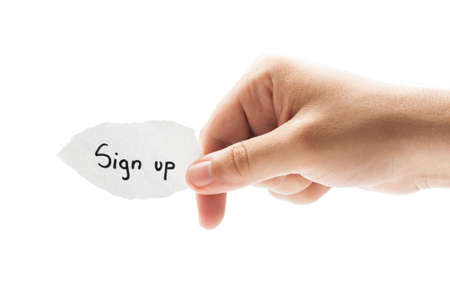 Sign up concept using a hand holding a piece of paper on white background photo