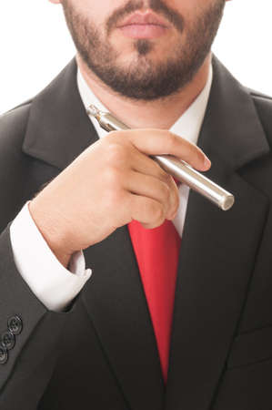 Business man smoking electronic cigarette. He wears clasic black suit and red tie. photo