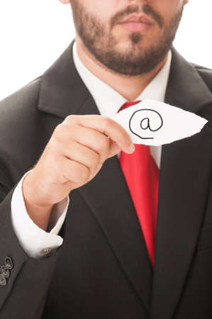 Email symbol concept using a man wearing a black suit and red necktie and holding a piece of paper with the email symbol on it. photo