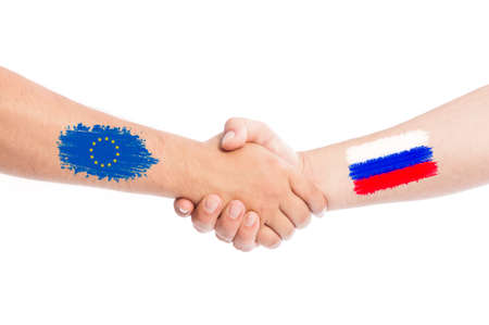 European Union and Russia hands shaking with flags painted on arms concept. Isolated on white background. photo