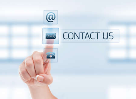 Contact us concept using woman hand touching a button. Futuristic contact us concept on light blue