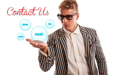 Contact us concept using a man holding bubbles with words fax, phone, email and www. Isolated on white background photo
