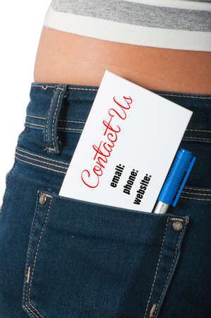 Contact us concept using card or paper on back pocket of a womans jeans photo