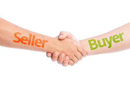 Seller and Buyer shaking hands. Commerce trade concept usig hand shake isolated on white background. Standard-Bild