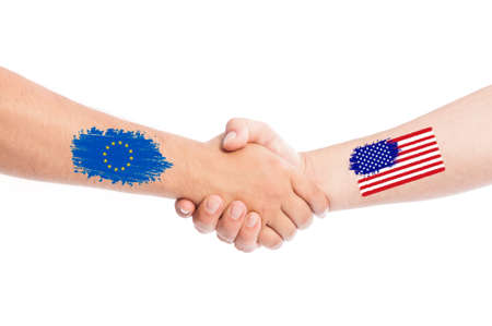 European Union and USA hands shaking with flags painted on arms concept. Isolated on white background. photo