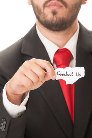 Contact us concept using an elegant man holding a piece of paper. He wears an elegant black suit and a red necktie. photo