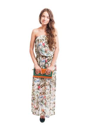 Long hair female model posing holding a purse isolated on white studio background photo