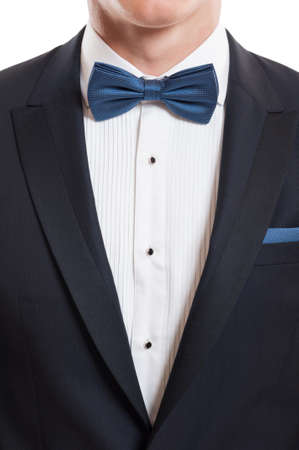 dinner wear: Closeup with elegant designer suit, white shirt, blue  bow tie and blue pocket handkerchief