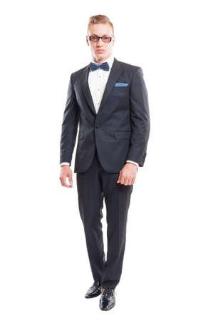 bowtie: Elegant male model wearing suit, bowtie and sun glasses