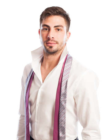 open collar: One handsome male model with open collar shirt and two neckties hanging Stock Photo