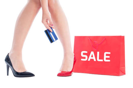 Credit card shopping sale concept using red shopping paper bag and woman holding a credit card photo