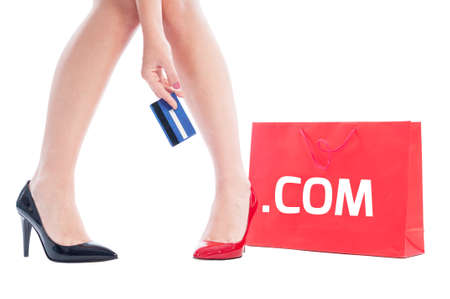 dot com: Dot com shopping concept using woman holding credit card and red shopping bag Stock Photo