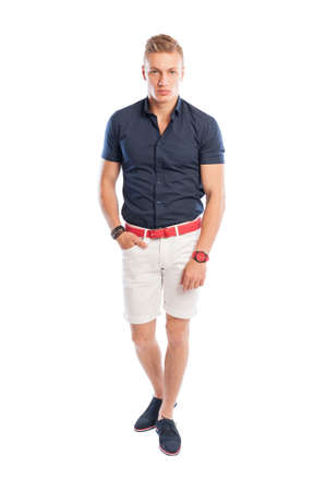 summer clothes: Fashion guy wearing summer clothes, white short pants, and blue shirt with red belt and watch