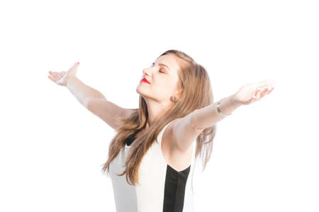 Successful business woman with arms wide open on white background photo