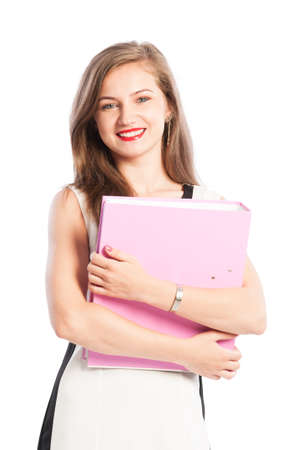 industrious: Smiling business woman holding portolio with both hands Stock Photo
