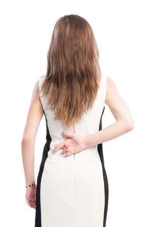 Business woman holding fingers crossed behind her back photo