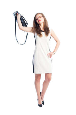 impassive: Careless business woman throwing away her handbag while walking