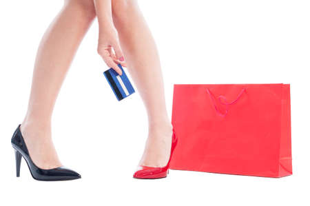 Woman shoes and legs, shopping bag and credit card photo