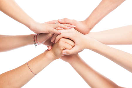 Volunteers joining hands isolated on white background photo