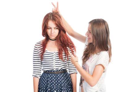 arrogant teen: Bully rabbit ears prank between girls
