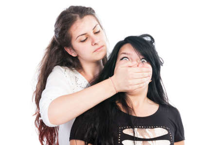 hair cover: Older girl bullying her younger friend by covering the mouth using hand