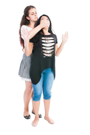taller: Taller girl bullying her friend by covering the mouth with hand and pulling her hair