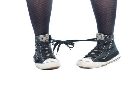 shoe laces: Shoe laces tied together prank isolated on white background Stock Photo