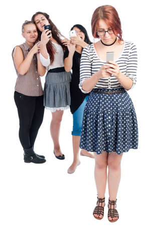 cyber bullying: Bullying girls using smartphones isolated on white background.