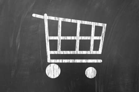 checkout line: White shopping cart symbol on blackboard
