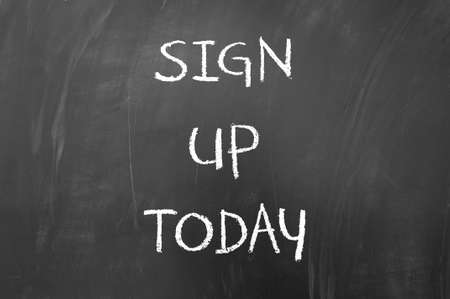 today: Sign up today concept on blackboard Stock Photo