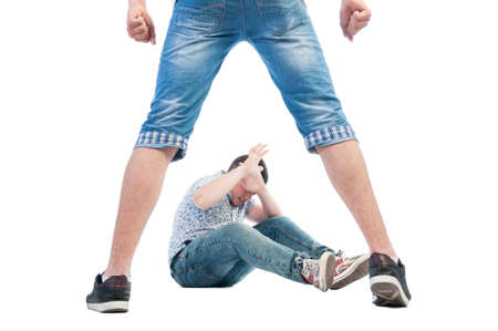 attacker: Aggressive boy bullying younger kid Stock Photo