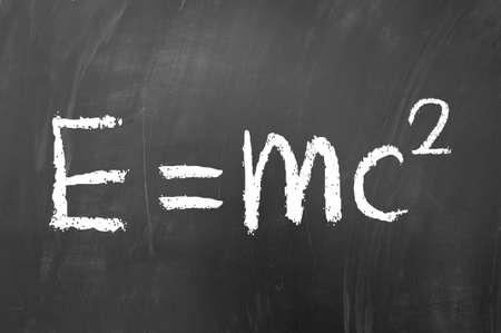 mc2: E equals mc squared drawn with white chalk on blackboard