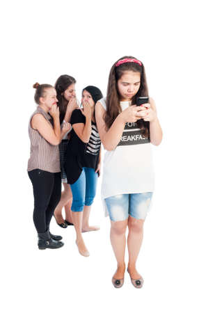 cyber bullying: Mean and bullying teen girls. Full body on white background Stock Photo