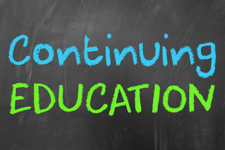 education concept: Continuing education concept on blackboard Stock Photo