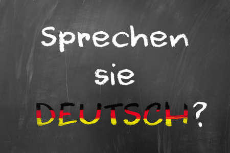 deutsch: Sprechen sie deutsch question on blackboard Stock Photo