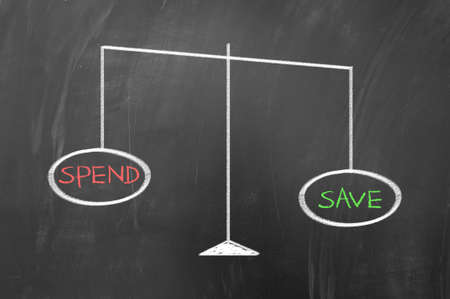 Spend and save on scale concept on blackboard