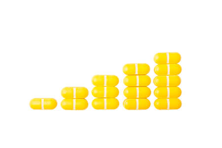 Rising graph of pills isolated on white background photo