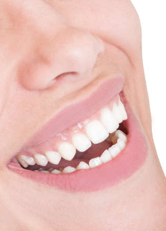 Closeup of a female mouth with perfect smile and teeth photo