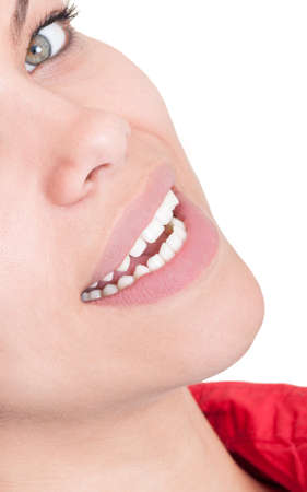 Half face with beautiful smile in dentist office on white background photo