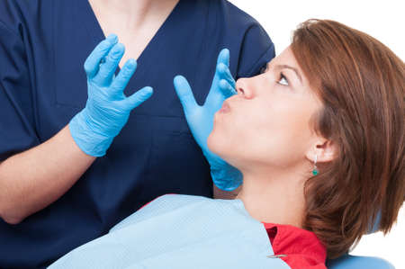 stubborn: Stubborn patient in dentist office who dont want to open the mouth Stock Photo