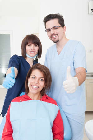 thumbsup: Friendly dentist team and patient with thumbs-up Stock Photo