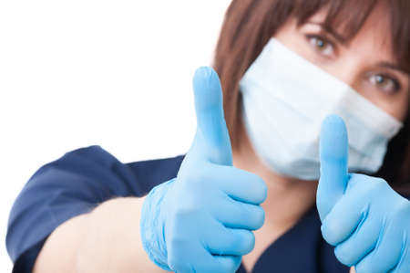 thumbsup: Dentist woman holding both thumbs-up with focus on hands Stock Photo