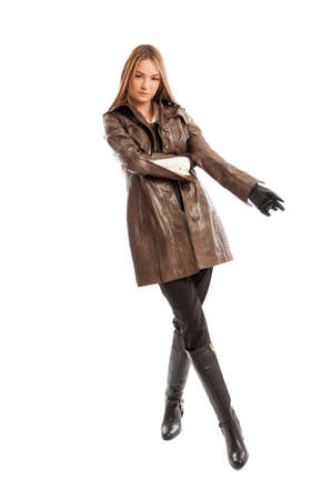 leather gloves: Beautiful young female model with confident attitude posing Stock Photo